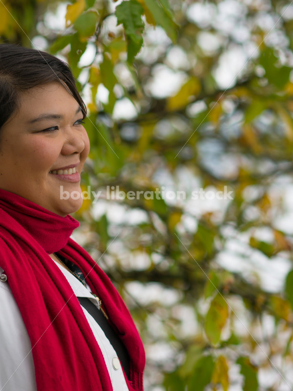 Stock Photo: Young Asian American Woman with Tree Branches - Body Liberation Photos