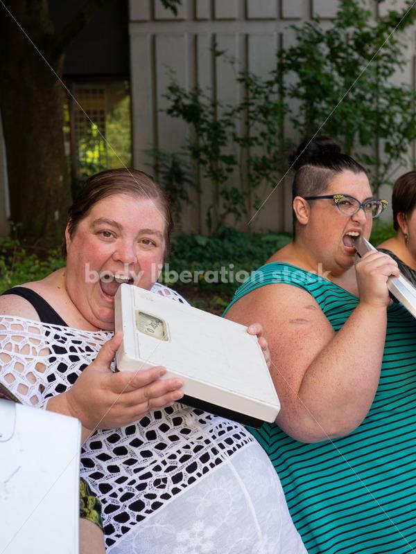 "Anti-Diet Stock Image: Women ""Eat"" Bathroom Scales - Body Liberation Photos"