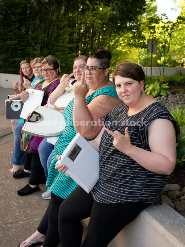 Anti-Diet Stock Image: Women Give the Finger to Bathroom Scales - Body Liberation Photos