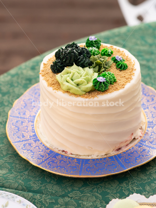 Close-up of Decorated Cake on Tea Party Table - Body Liberation Photos