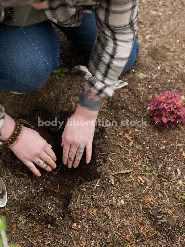 Diverse Gardening Stock Photo: Agender Person Digs with Trowel - Body Liberation Photos