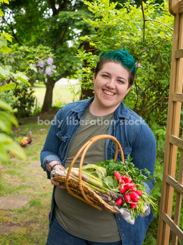 Diverse Gardening Stock Photo: Agender Person Holds Basket of Fresh Produce - Body Liberation Photos