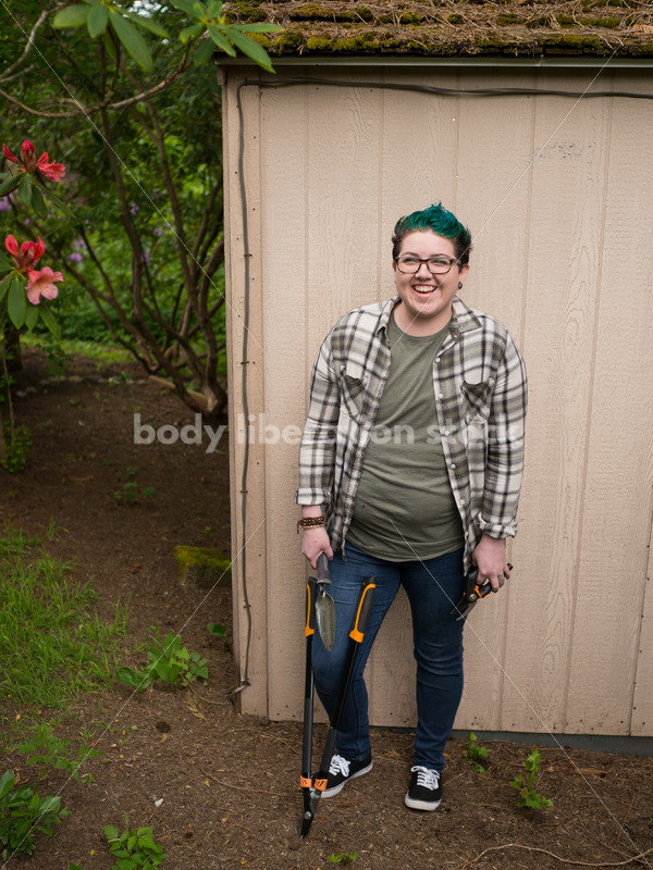 Diverse Gardening Stock Photo: Agender Person Holds Hand Tools - Body Liberation Photos