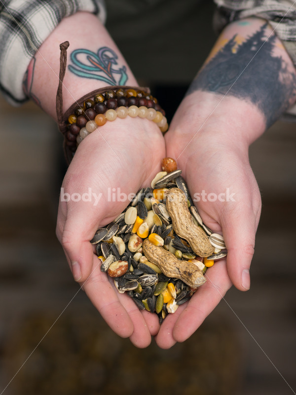 Diverse Gardening Stock Photo: Agender Person Holds Nuts and Seeds - Body Liberation Photos