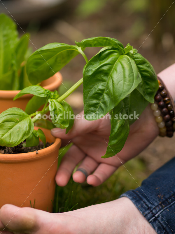 Diverse Gardening Stock Photo: Agender Person Meditates in Garden - Body Liberation Photos