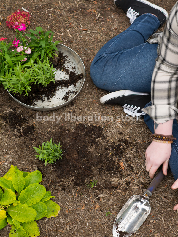 Diverse Gardening Stock Photo: Agender Person Plants Seedling - Body Liberation Photos