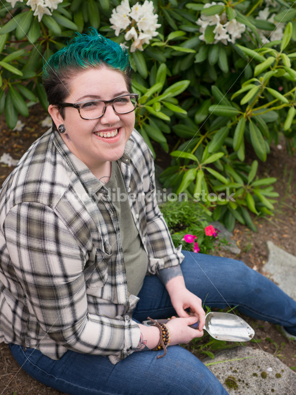Diverse Gardening Stock Photo: Agender Person Sitting with Trowel - Body Liberation Photos