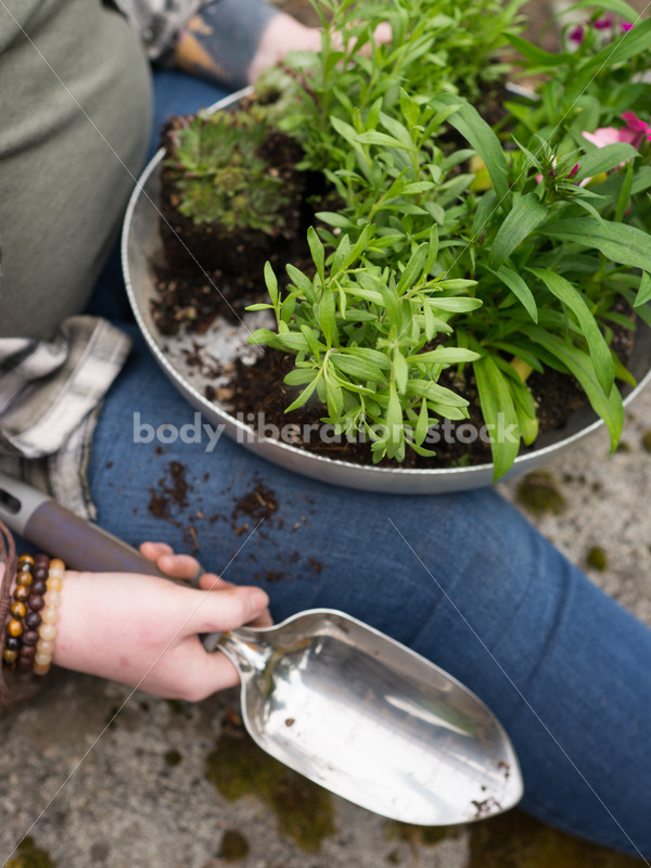 Diverse Gardening Stock Photo: Agender Person with Trowel and Seedlings - Body Liberation Photos