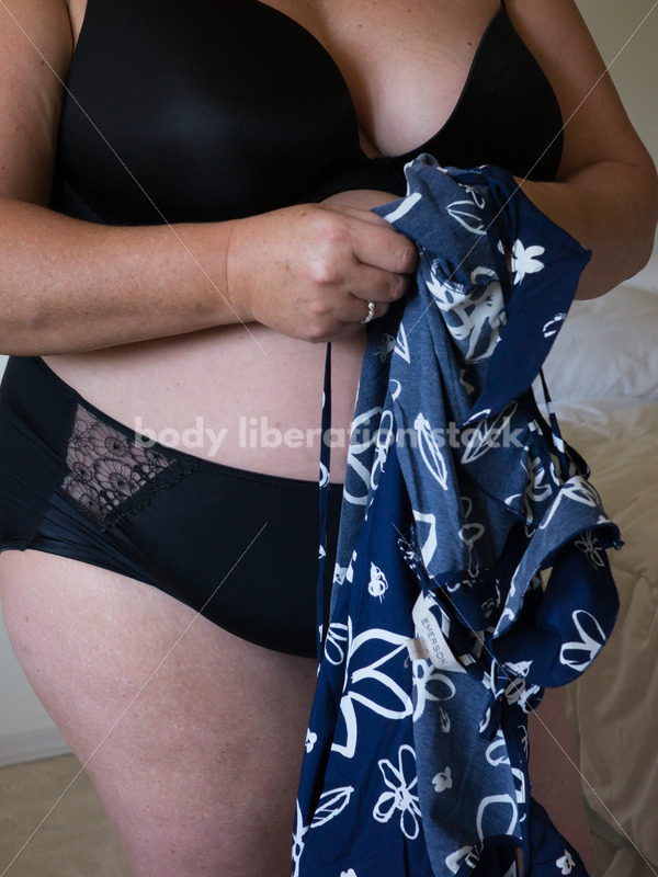 Eating Disorder Recovery Body Image Stock Photo: Woman Dressing in Bedroom - Body Liberation Photos