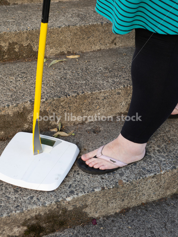 Eating Disorder Recovery Stock Image: Woman Smashing Bathroom Scale - Body Liberation Photos