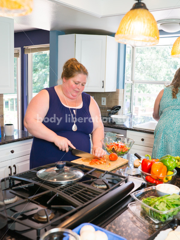 Eating Disorder Recovery Stock Photo: Woman Chops Vegetables in Kitchen - Body Liberation Photos