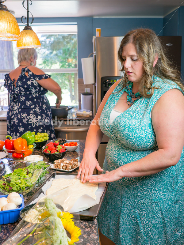 Eating Disorder Recovery Stock Photo: Woman Preparing Pizza Dough in Kitchen - Body Liberation Photos