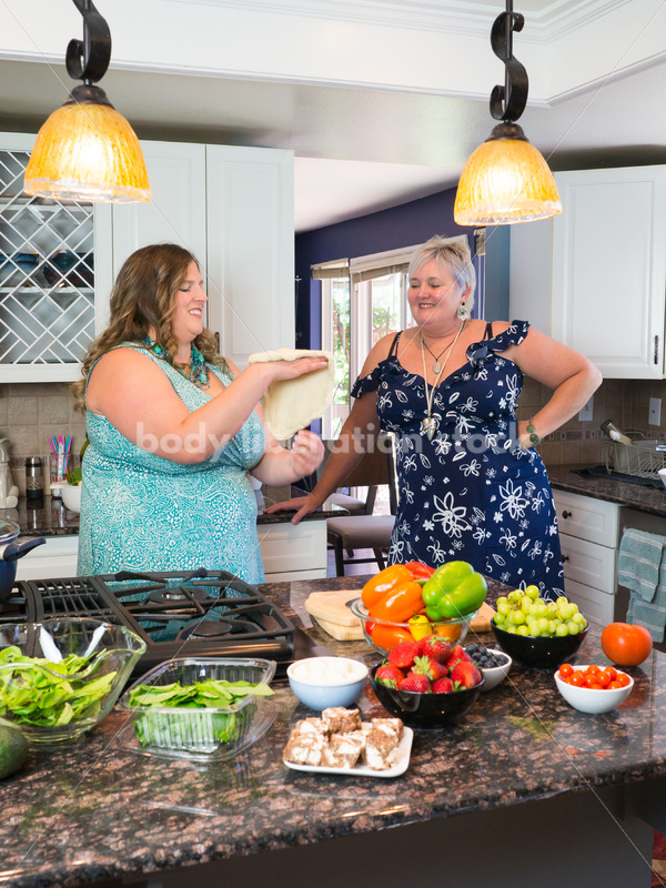 Eating Disorder Recovery Stock Photo: Woman Tossing Pizza Dough in Kitchen - Body Liberation Photos