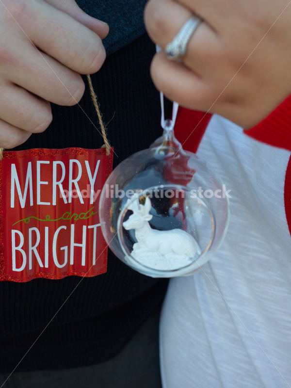 Holiday Stock Image: Plus-Size Couple with Christmas Tree Ornaments - Body Liberation Photos
