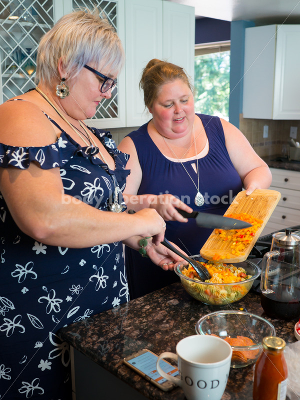 Intuitive Eating Recovery Stock Photo: Women Prepare Pasta Salad in Kitchen - Body Liberation Photos