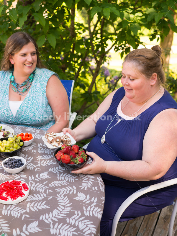 Intuitive Eating Stock Image: Woman Chooses Foods During Outdoor Meal - Body Liberation Photos