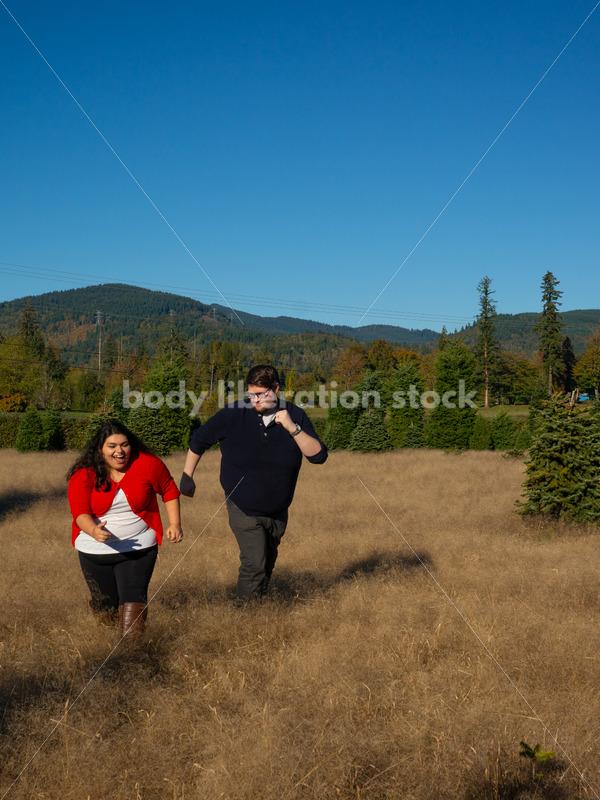 Joyful Movement Stock Image: Couple Running in Field - Body Liberation Photos