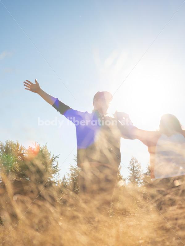 Joyful Movement Stock Image: Couple in Field - Body Liberation Photos