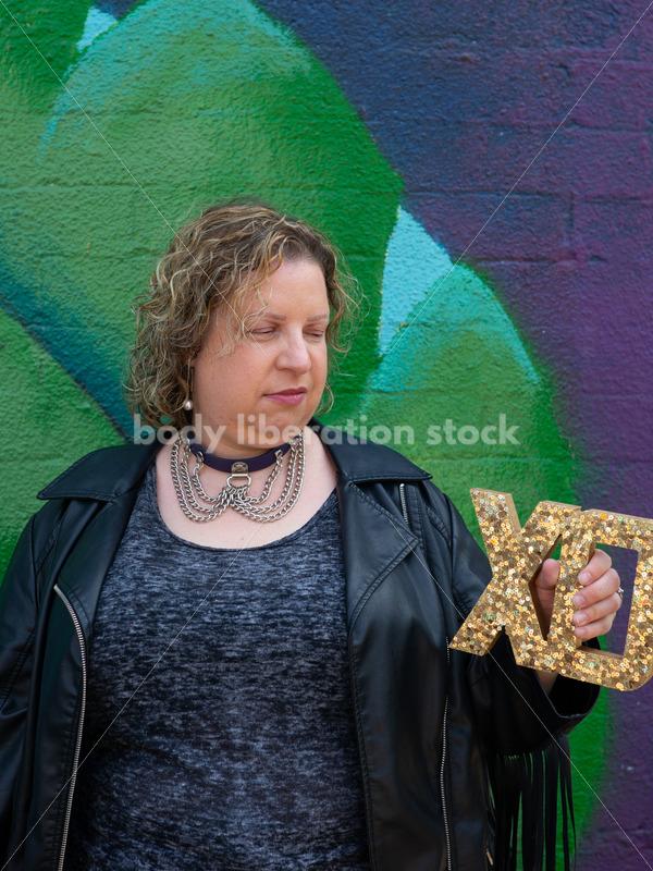 Love, Romance, Valentines Stock Photo: Plus-Size Woman Holding XO Sign - Body Liberation Photos