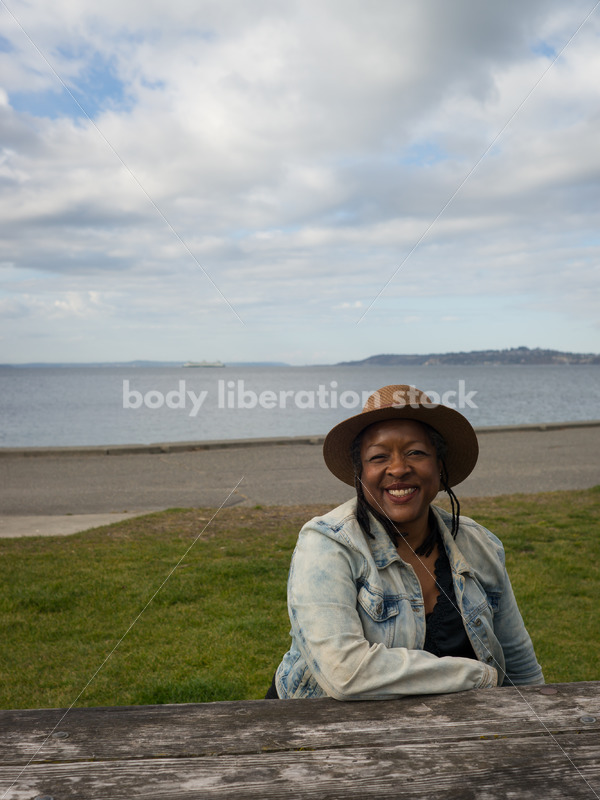Plus-Size African American Woman Outdoors Relaxing at Picnic Table - Body Liberation Photos