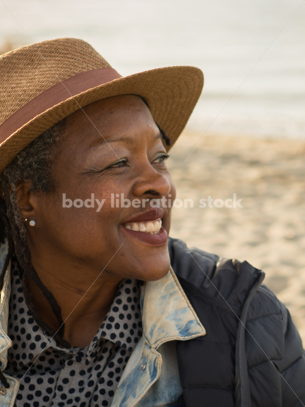 Plus-Size African American Woman Outdoors Relaxing on Beach - Body Liberation Photos