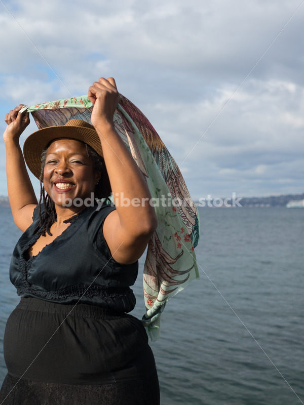Plus-Size African American Woman Outdoors with Winged Scarf - Body Liberation Photos