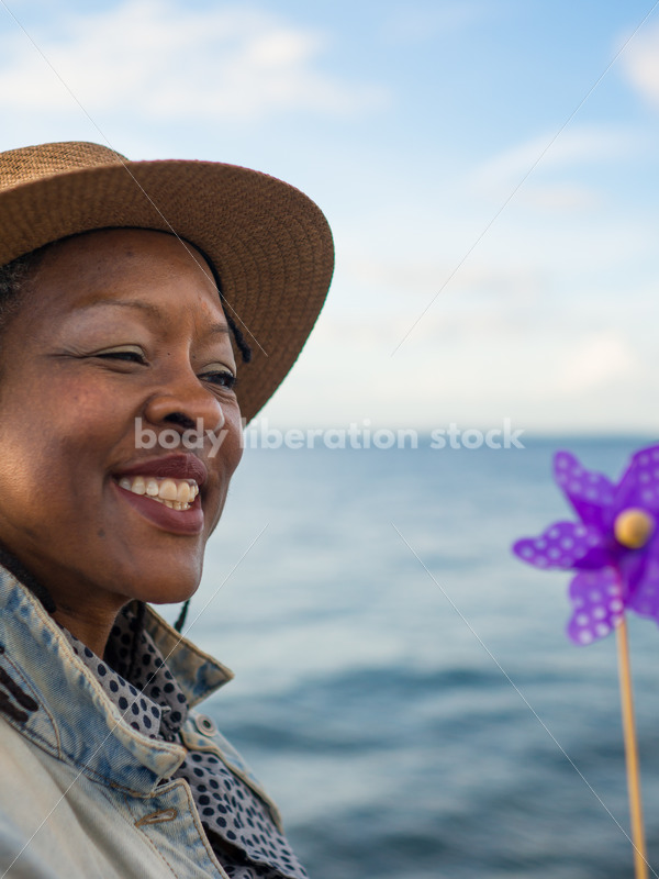 Plus-Size African American Woman with Pinwheel - Body Liberation Photos
