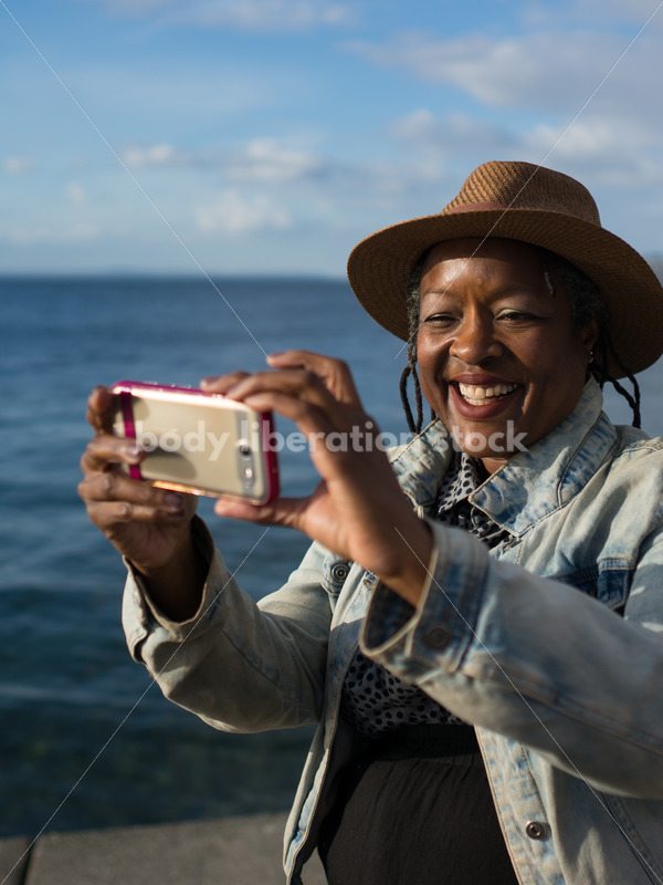Plus-Size African American Woman with Smartphone - Body Liberation Photos