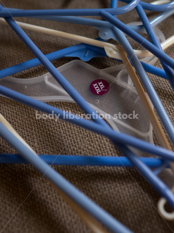 Plus-size clothing hangers - Body Liberation Photos