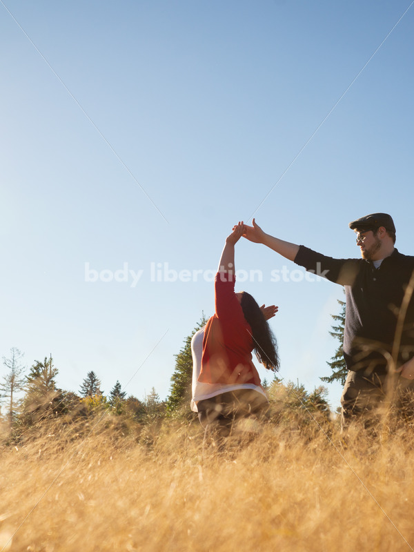 Romance Stock Image: Couple Dancing in Field - Body Liberation Photos