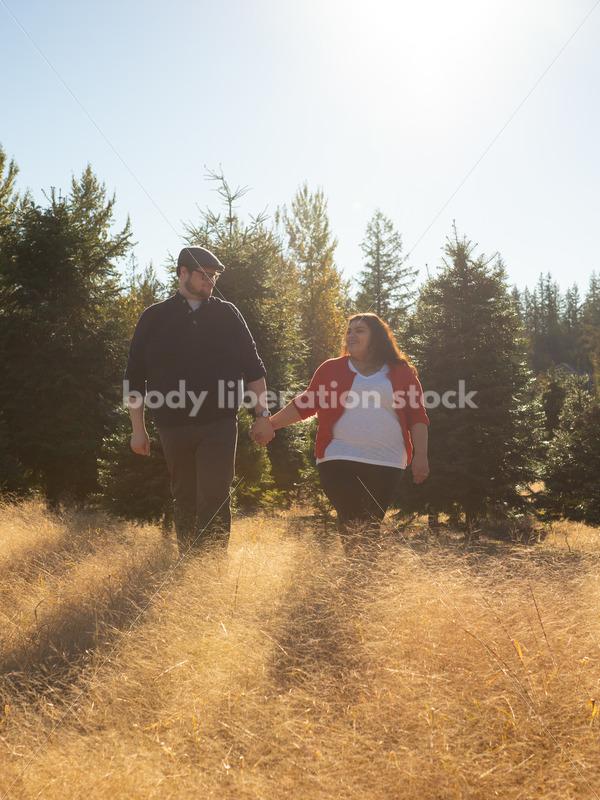 Romance Stock Image: Couple Walking Through Field - Body Liberation Photos