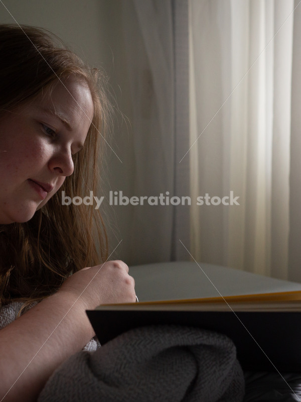 Self Care Stock Photo: Plus-Size Woman Reading in Bed - Body Liberation Photos