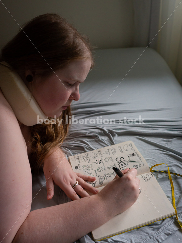 Self Care Stock Photo: Plus-Size Woman Writing and Journaling in Bed - Body Liberation Photos