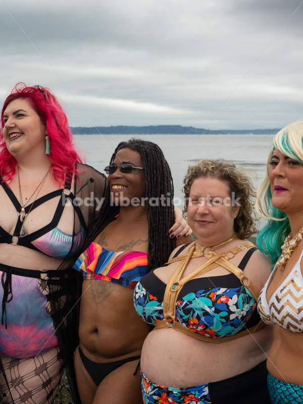 Stock Image: Group of friends walking on beach - Body Liberation Photos