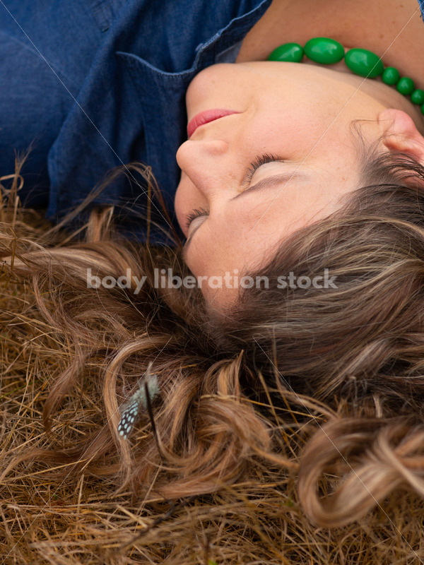 Stock Image: Plus-Size Woman with Feathers in Grass - Body Liberation Photos