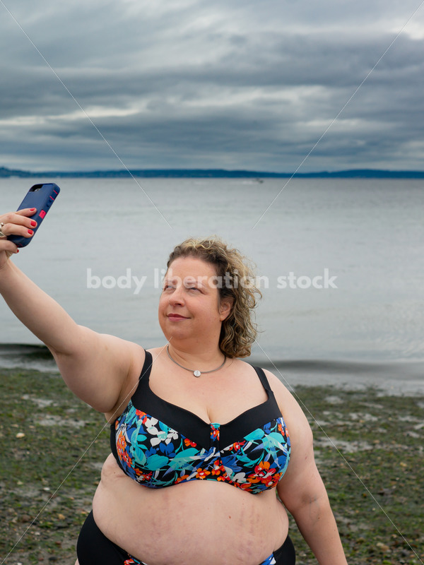 Technology Stock Image: Smartphone on the Beach - Body Liberation Photos