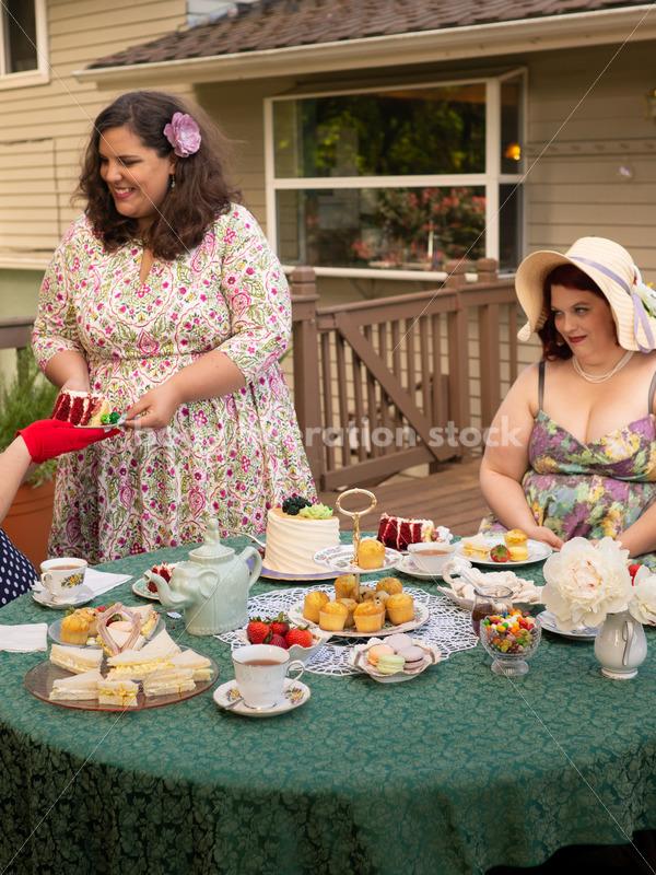 Woman Cuts Cake at Tea Party - Body Liberation Photos