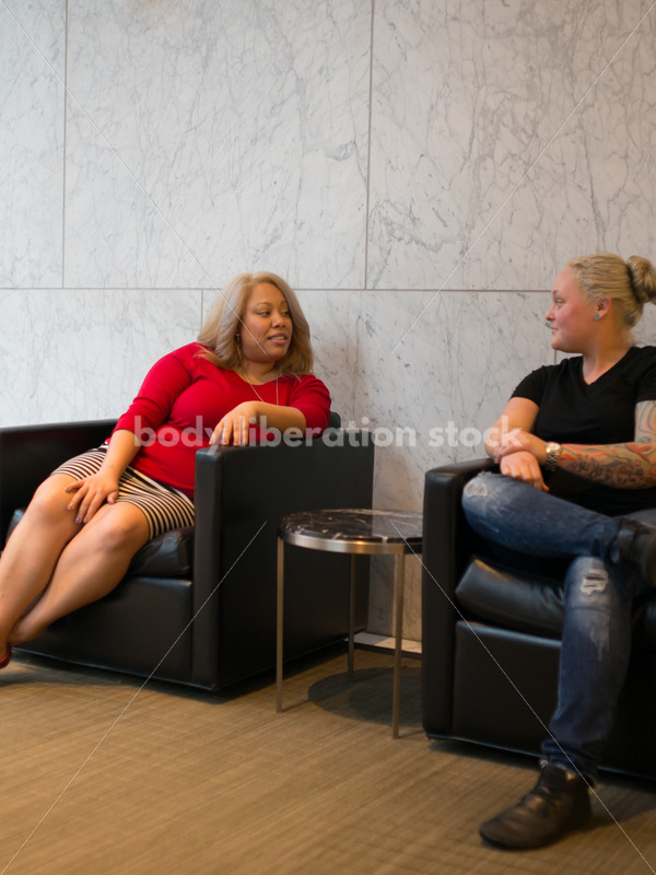 Diverse Business Stock Image: LGBT Women Talk in Office Building - Body Liberation Photos