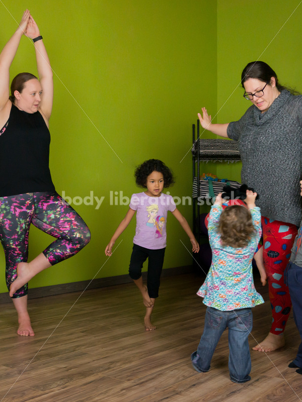 Joyful Movement Stock Image: Family Yoga Class - Body Liberation Photos