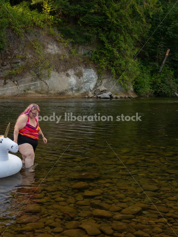 Plus-Size Lifestyle Stock Photo: Woman with Unicorn Float - Body Liberation Photos
