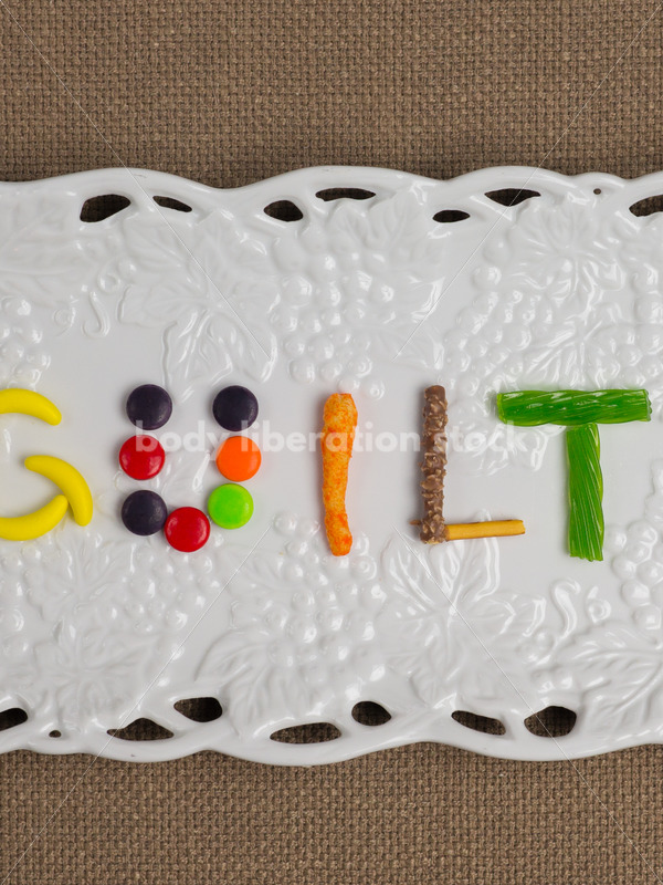Stock Photo: Diet Recovery Concept GUILT Spelled Out in Candy - Body Liberation Photos