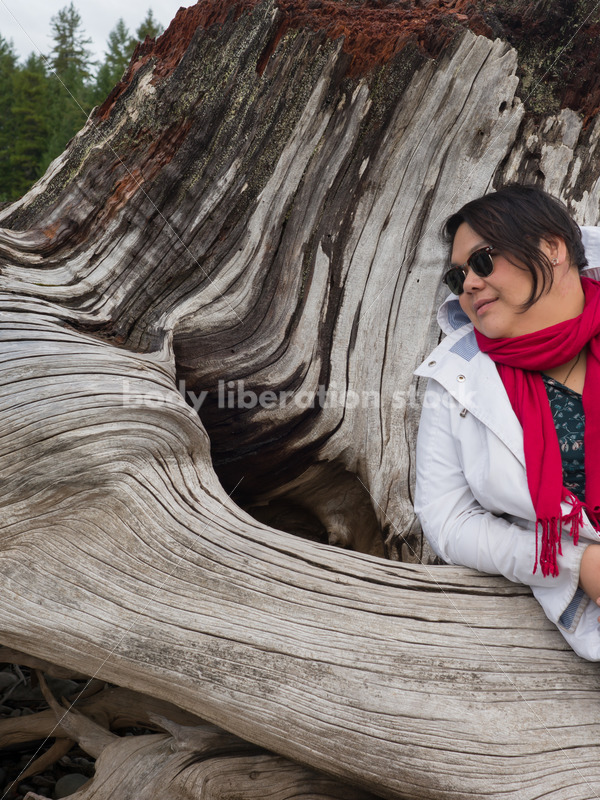 Stock Photo: Young Asian American Outdoors with Tree Trunk - Body Liberation Photos
