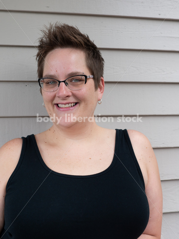 Woman outdoors against gray wall - Body Liberation Photos