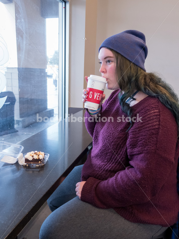 Young caucasian women enjoys coffee and a brownie - Body Liberation Photos