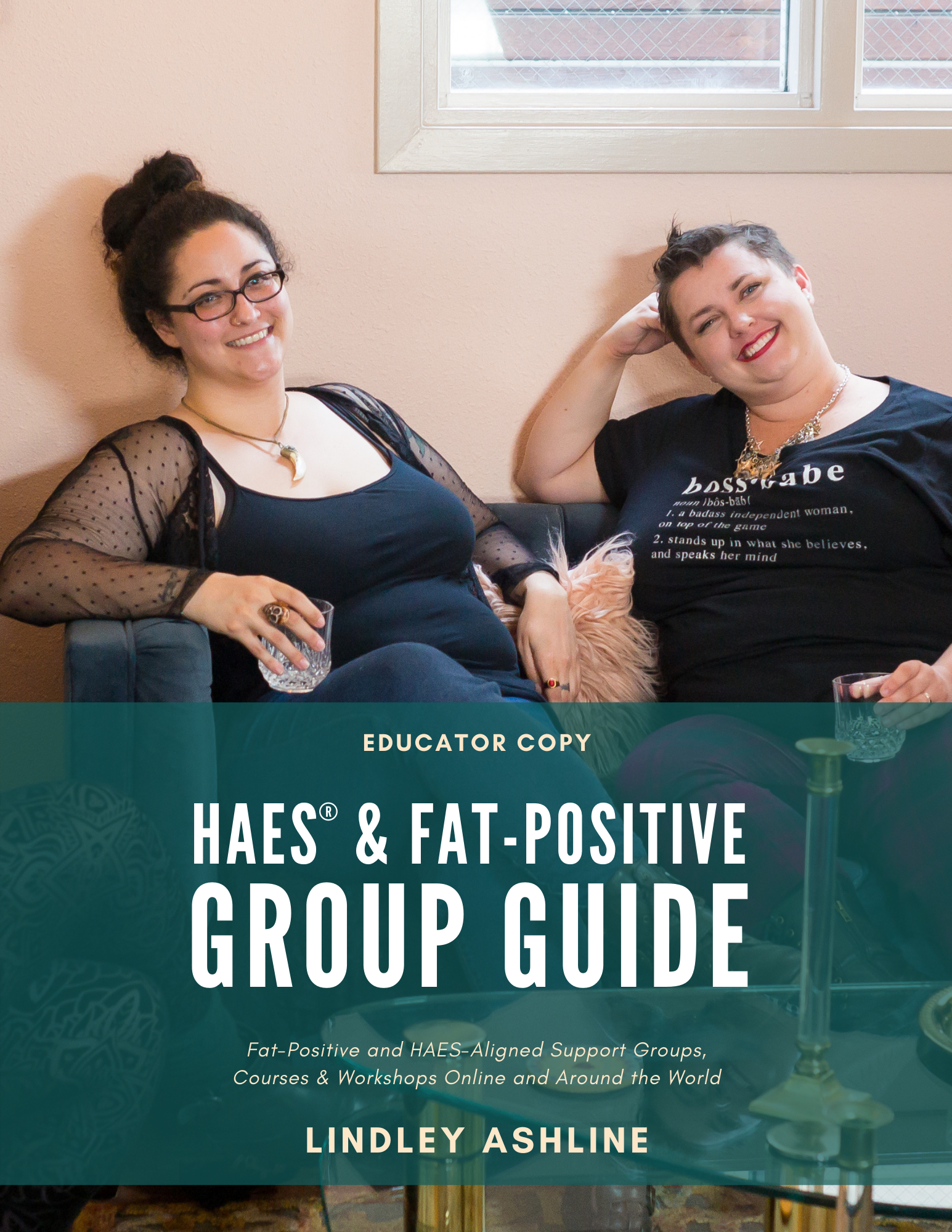 Book cover with two plus-size women relaxing on a couch and the book title.